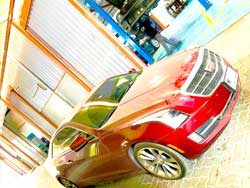 Cadillac is at Quick Fit for Auto Maintenance and Detailing