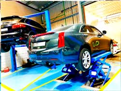Cadillac Suspension Service is going at Quick Fit Auto Center